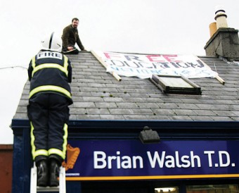 The scene at Brian Walsh's office yesterday when a protestor climbed onto the roof.