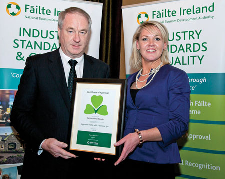 Tony Lenehan, Fáilte Ireland's head of quality and standards, presents Sophia Weir, director of spa operations, Carlton Atlantic Coast Hotel, with the Fáilte Ireland Spa Accreditation Certificate.