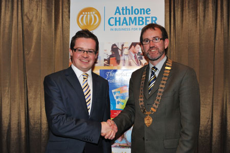 Outgoing president of Athlone Chamber, Michael O'Brien, congratulates new president John McGrath