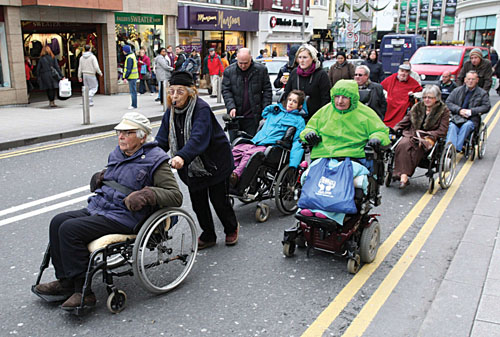 John Arden and Margaretta D'Arcy pictured leading the recent Speakout to highlight the difficulties for wheelchair users in Galway city. Photo: Mike Shaughnessy.