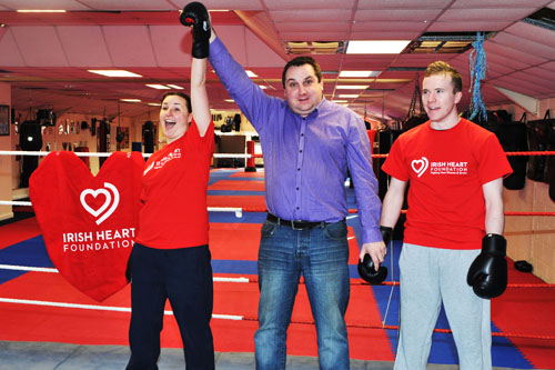 And the winner is...Ollie Turner, Galway Bay FM's head of sport practising his refereeing skills at the announcement of the Irish Heart Foundation's Big Heart Fight Night white collar boxing fundraiser with the Galway Advertiser's Donna Larkin, All-Ireland kickboxing champion, and Eric Daly, IKF European champion (Photo: Joe Travers)