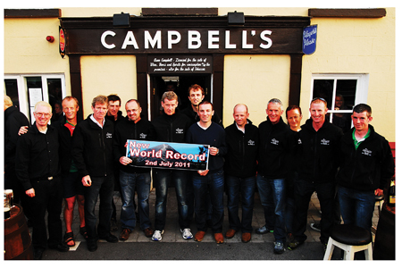 Record setters: Padraig of Campbells's Bar with Paul Mahon, PJ Hall, Kieran Hastings, Pat Staunton, Tony Walsh, Rob Coyne, John Gilleran, Sean Quirke, Noel Brady, Mary Mulchrone, Padraig Marrey and Padraic Hughes who were all part of the World Record setting multiple climb of Croagh Patrick last year.