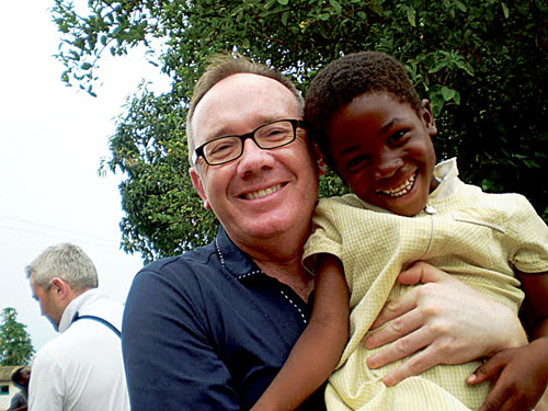 HP chief Mark Gantly pictured with one of the children benefitting from the AKP and HP contributions.
