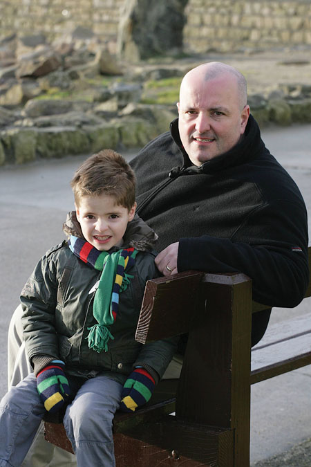 Local newsagent Paul O'Brien and his four-and-a-half year old son Daniel who was born three months before he was due weighing just 2lbs 7ozs.