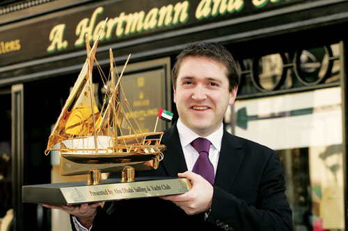 Richard Hartmann with the gold dhow presented by Abu Dhabi Sailing & Yacht Club. Photo:-Mike Shaughnessy