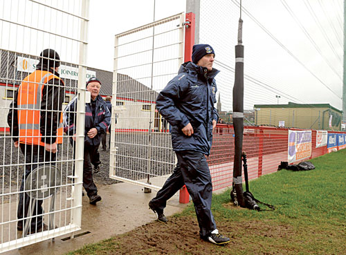 Making strides — Galway manager Alan Mulholland enters the pitch for the game against Derry last Sunday.