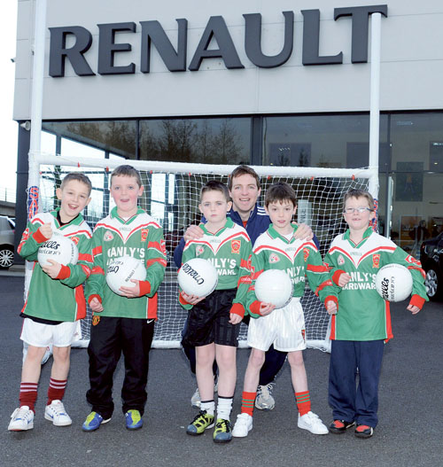 Garrycastle captain John  Gaffey pictured with the  Garrycastle u10 squad at  Sean White Car Sales