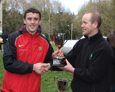 Best in the land: Race organiser Anthony Lee presents John Byrne with Irish 50k trophy after his victory last weekend.