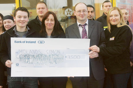 Staff of Kilmartins N6 Service Station present a cheque for €7,500 to Cormac Lally of the Midlands Simon Community
