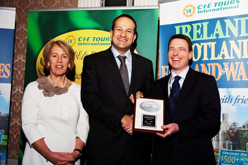 Chairperson, CIE, Vivienne Jupp, Minister for Transport, Tourism and Sport Leo Varadkar with Dan Murphy, director/general manager of Galway Bay Hotel receiving a CIE Award of Excellence.