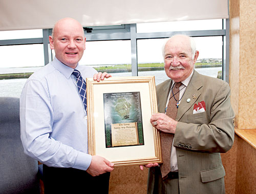 Galway harbour master, Captain Brian Sheridan, being presented with a framed scroll of thanks for his work in support of the Galway Famine Ship Memorial by Mark Kennedy, Famine Memorial Committee chairman.