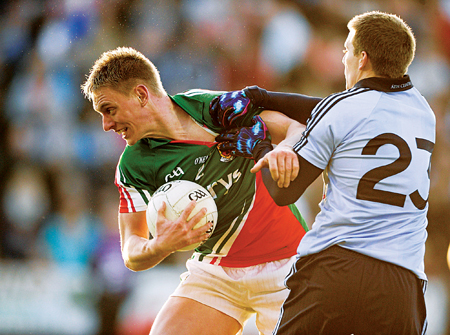 Power drive: Mayo's Kevin Keane, powers away from the challenge of Dublin's Tomas Quinn last Saturday night. Photo:Sportsfile