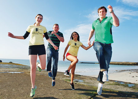 Simon Says….. Run! At the launch of the Galway Simon Women's Mini Marathon in sunny Salthill were Niall O'Connor  and Dave Moore, Connacht Rugby, with Catwalk models  Kamile Jucyte and Marie-Christine Kienlen.  The Galway Simon Women's Mini Marathon will take place on Sunday, June 24 and participants can now register on www.galwaysimon.ie. Photo: Andrew Downes.