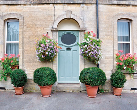 Flowers will help brighten up the entrance to your home.