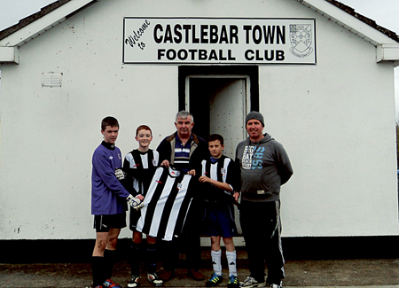 New jersey for the season: Niall McHale, Feildham Barrett, Tony Flynn (sponsor), Kasper Gronchki, and Noel Barrett (manager) with the new Castlebar Town u15 jersey.