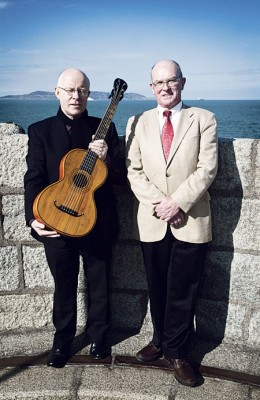 John Feeley and Professor Fran O'Rourke with James Joyce's restored guitar.