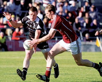 Galway's Greg Higgins and Sligo's Tony Taylor in action from the Connacht Senior Football Championship semi-final at Pearse Stadium on Saturday. Photo:-Mike Shaughnessy