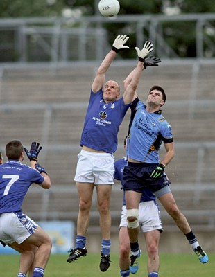 Frank Daly of St Michael's and Salthill Knocknacarra's Conor Healy in action from the senior football championship game at Pearse Stadium on Saturday.  					Photo:-Mike Shaughnessy