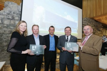 Pictured are Michelle Fagan, president Royal Institute of Architects of Ireland; Niall Taylor, Taylor Architects, (receiving their award in front of an image of the new school of engineering); Conor Pittman RMJM; Aodh Dalton NUI Galway; and Ruairi Quinn, Minister for Education and Skills.