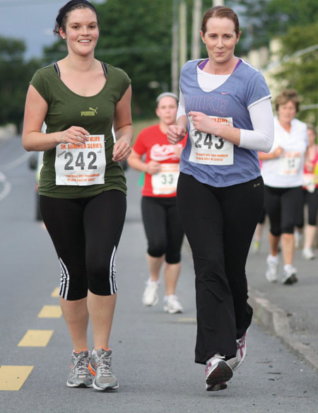 Running to the line: Liz Walsh and Tracy Kennedy keep up the pace in the  Ballyhaunis 5K.