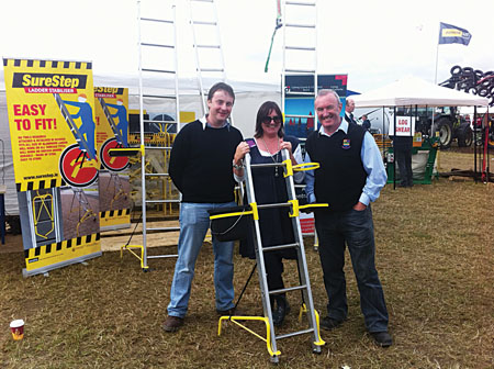 JP Prendergast CEO WeSolve Ltd,  Breda Fox CEO, Galway City & County Enterprise Board, Mike Gallagher CFO WeSolve Ltd, pictured with the SureStep ladder stabiliser, one of the company's products.