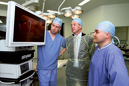 (From left to right) Chris Collins PhD FRCSI, John Donovan, sales manager at MED Surgical, and Eddie Myers MD FRCSI demonstrating the state-of-the-art equipment which has been installed by MED.Surgical, a SISK Group company, in the operating theatres in Portiuncula Hospital in Ballinasloe.