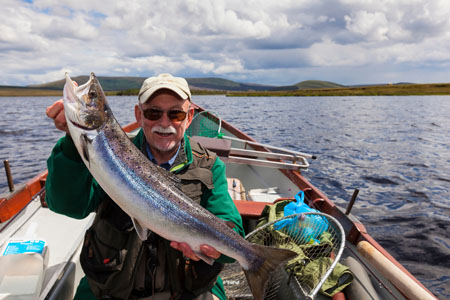 British angling journalist Russell Symons with his first fish of the day on Carrowmore Lake, Co Mayo, during a recent fact-finding trip organised by Tourism Ireland.