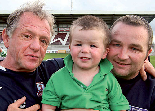 James O'Toole manager of Galway United with William Grant manager of West United and team mascot Daire Grant, pictured ahead of Saturday's game. Photo:-Mike Shaughnessy