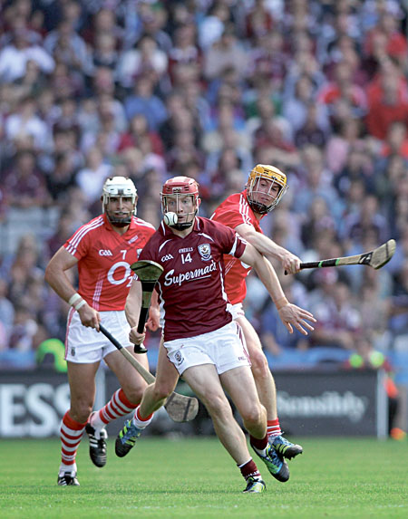 Galway's Joe Canning burst through Cork's Sean Og O hAilpin and Cathal Naughton in the All Ireland senior hurling championship semi-final at Croke Park on Sunday. 		Photo:-Mike Shaughnessy