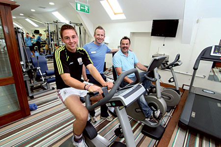 Fit for champions — Niall Burke, Galway Senior Hurler getting pointers from former All Ireland hurling star Gerry McInerney (McInerney Sports) with David Shanagher of the Oranmore Lodge Leisure Centre.