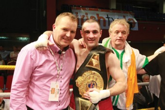 Mayo TV presenter Pierce O'Reilly with Henry Coyle and his father Gerry Coyle at the TF Royal Hotel and Theatre after the fight last Friday night.