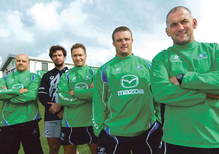 Flanked by coaches Dan McFarland (left) and Eric Elwood (right), new signings Danie Poolman, Dan Parks, and Nathan White are expected to boost Connacht's competitiveness this season.		Photo: Mike Shaughnessy.