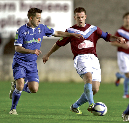 SD Galway's Michael Harty evades Limerick FC captain Pat Purcell in action from the Airtricity League game at Deacy Park on Friday night. 			Photo:-Mike Shaughnessy