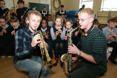 Peter and Mathew Berrill from Galway Jazz Festival join pupils from the Claddagh National School for a 'Jazz For Juniors' workshop in advance of the Galway Jazz Festival which kicks off on October 9.