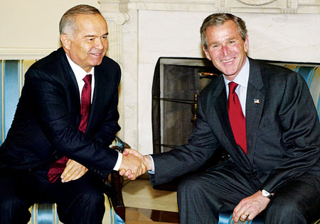 Islam Karimov and George W Bush. Photo: Alex Wong