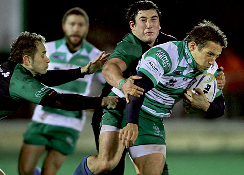 Connacht's Dan Parks and prop Denis Buckley tackle Benetton Treviso centre Andrew Vilk in action from the RaboDirect Pro12 league game at the Sportsground on Saturday. 			Photo:-Mike Shaughnessy