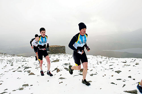 Snow in November: Gerard Corcoran (winner) and Robert Staunton (third place) in the Westport Sea 2 Summit adventure race on the top of Croagh Patrick last weekend, where 1100 athletes ran, cycled, and hiked 56km (summit) in Co Mayo. Photo: Andrew Downes.