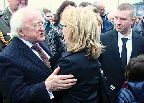 Remembering Tommy — President Michael D Higgins sympathises with Paula O'Flaherty, partner of Tommy Keane at the funeral of former Galway United soccer player Tommy Keane at the Sacred Heart Church yesterday Wednesday. See inside for tributes. Photo:-Mike Shaughnessy