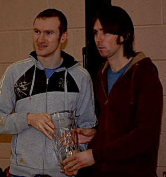 Galway Olympian Paul Hession presents Raheny's Mick Clohissey with the winning trophy in this year's Fields of Athenry 10km.