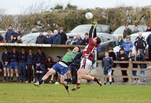 Dessie Dolan out-jumps Eoin Kerins during last Sunday's O'Byrne cup fixture in Moate.  Photo: johnobrienimages.com