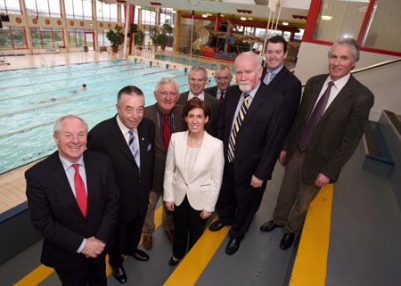 Relaxing poolside are Minister Ring and city councillors and officials.