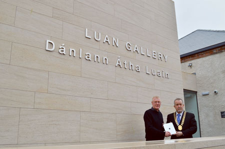 Winner of the gallery naming competition, Tom O'Neill, is presented with his prize of an iPad by Mayor of Athlone Jim Henson.