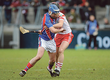 Richie Murray, St Thomas, in action against Neil McGarry, Loughgiel Shamrocks.