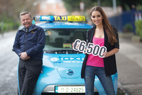 Padraig Daly with Tara O'Farrell at the announcement of the savings made by Padraig, the driver of the e-Taxi, over the last 18 months.