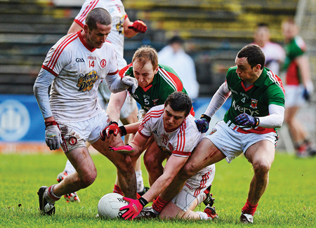 Eyes on the prize: Keith Higgins and Tom Cunniffe go in with Tyrone's Stephen O'Neill and Conor McAlliskey for the ball last Sunday. Photo: Sportsfile