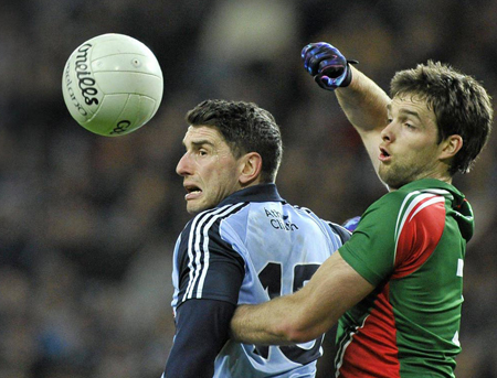 My ball: Ger Cafferkey battles for the ball with Bernard Brogan in Croke Park, last Saturday night. Photo:Sportsfile