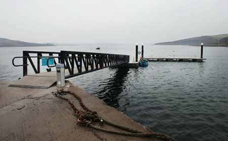Picture of Rosmoney pier where the new pontoon was opened to the public last week. This community project was supported by Mayo County Council and funded by South West Mayo Development Company through the LEADER/ Rural Development Programme. Photo: Michael McLaughlin
