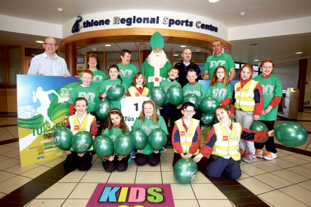 Ready to run: Liam Cunningham, Madeline Mullins, Jean Naughton, Terry Rafferty (St Patrick), Ger O'Donoghue, and Martin Fallon are pictured with pupils of Scoil na gCeithre Maistri, Athlone  who made the kilometre signposts for the SVP Paddy Run