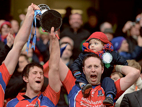 A proud moment: Enda Tannion, with two-year-old son Matthew, celebrates St Thomas' victory in the All Ireland Senior Club Hurling Championship final with clubmate Kenneth Burke in Croke Park on St Patrick's Day.