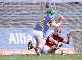 Galway's Fergal Moore attempts to stop Tipperary's John O'Brien from scoring in action from the Allianz National Hurling League game in Pearse Stadium on Monday. Photo:-Mike Shaughnessy